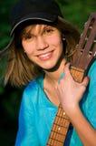 Adolescente con la guitarra Fotografía de archivo