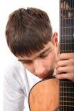 Adolescente con la guitarra Foto de archivo