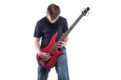 Adolescente con la guitarra baja Fotos de archivo