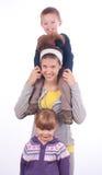 Adolescente con la hermana y el hermano Fotografía de archivo