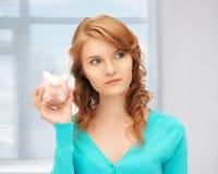 Adolescente con la hucha Foto de archivo