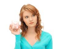 Adolescente con la hucha Imagen de archivo libre de regalías