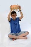 Adolescente con la hucha Imagen de archivo