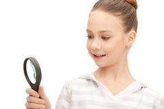 Adolescente con la lupa Imagen de archivo libre de regalías