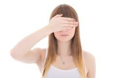 Adolescente con la mano en los ojos aislados en blanco Foto de archivo libre de regalías