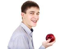Adolescente con la manzana Imagenes de archivo