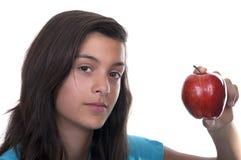Adolescente con la manzana roja Imagen de archivo