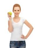Adolescente con la manzana verde Imágenes de archivo libres de regalías