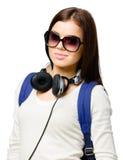Adolescente con la mochila y los auriculares Imagen de archivo libre de regalías