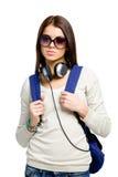 Adolescente con la mochila y los auriculares Fotografía de archivo libre de regalías