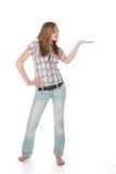Adolescente con la palma para arriba para la colocación del producto Imágenes de archivo libres de regalías