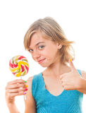 Adolescente con la piruleta colorida Imagen de archivo libre de regalías