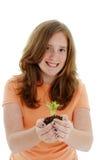Adolescente con la planta Fotografía de archivo libre de regalías
