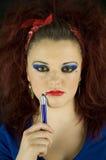 Adolescente con la pluma Foto de archivo libre de regalías