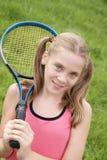 Adolescente con la raqueta de tenis Foto de archivo