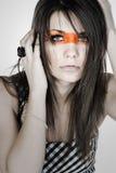 Adolescente con la raya de la manera a través de su cara Fotografía de archivo libre de regalías