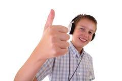 Adolescente con la risata delle cuffie Fotografia Stock Libera da Diritti
