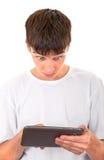 Adolescente con la tableta Foto de archivo libre de regalías