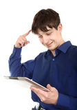 Adolescente con la tableta Imagen de archivo libre de regalías