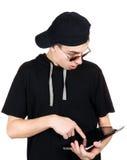 Adolescente con la tableta Fotografía de archivo libre de regalías