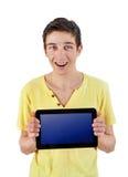 Adolescente con la tableta Imagenes de archivo