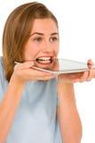 Adolescente con la tablilla en boca Imágenes de archivo libres de regalías
