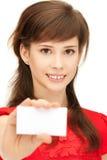 Adolescente con la tarjeta de visita Imagenes de archivo