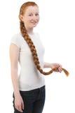 Adolescente con la trenza larga Foto de archivo libre de regalías