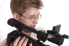 Adolescente con la videocámara de HDV Foto de archivo