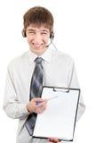 Adolescente con las auriculares y el tablero Fotos de archivo