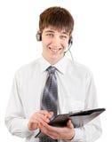 Adolescente con las auriculares y el tablero Imagen de archivo libre de regalías