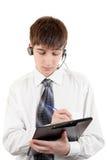 Adolescente con las auriculares y el tablero Imagenes de archivo