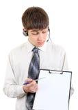 Adolescente con las auriculares y el tablero Fotografía de archivo libre de regalías