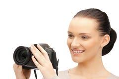 Adolescente con las cámaras digitales Fotos de archivo