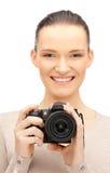 Adolescente con las cámaras digitales Fotografía de archivo