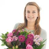 Adolescente con las flores Imagen de archivo libre de regalías
