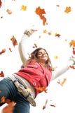 Adolescente con las hojas que caen Imagen de archivo libre de regalías