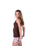 Adolescente con las manos en caderas Imagen de archivo