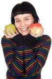 Adolescente con las manzanas Imagenes de archivo