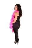 Adolescente con las plumas rosadas. Imagenes de archivo
