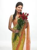 Adolescente con las rosas Foto de archivo libre de regalías