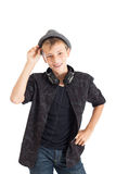 Adolescente con le cuffie che portano un cappello. Immagine Stock Libera da Diritti