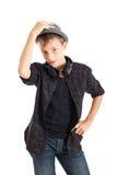 Adolescente con le cuffie che portano un cappello. Fotografie Stock Libere da Diritti