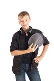 Adolescente con le cuffie che portano un cappello. Fotografia Stock Libera da Diritti