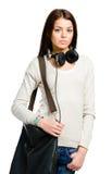 Adolescente con le cuffie e la borsa Fotografie Stock Libere da Diritti