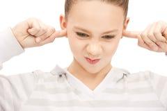 Adolescente con le dita in orecchie Immagini Stock Libere da Diritti