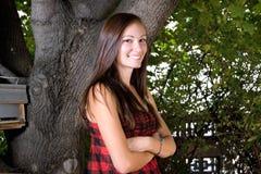 Adolescente con le sue braccia attraversate Fotografia Stock Libera da Diritti