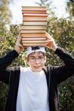 Adolescente con libros Fotografía de archivo libre de regalías