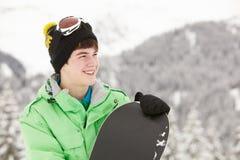 Adolescente con lo Snowboard sulla festa del pattino Immagine Stock
