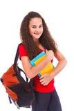 Adolescente con lo zaino ed i libri Immagini Stock Libere da Diritti
